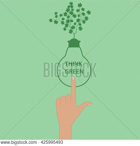 Think Green. Hand Shows A Finger At An Electric Light Bulb With A Tree Branch. Environmental Implica