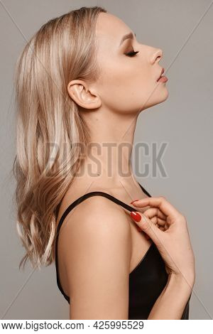 Portrait Of A Stylish Young Woman With Platinum Blonde Hairstyle And Perfect Makeup. Trendy Model Gi