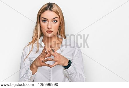 Young caucasian woman wearing casual clothes hands together and fingers crossed smiling relaxed and cheerful. success and optimistic