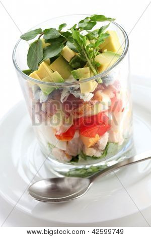 layered cobb salad in a glass cup
