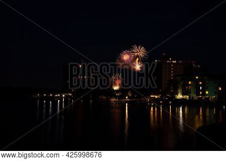 Fireworks Over Skyline Over Hickory Pass Leading To The Ocean In Bonita Springs, Florida.