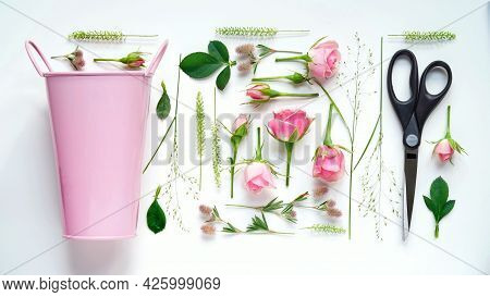 Floristic Composition Flat Lay.work Of The Florist,drawing Up A Flower Arrangement,on A White Table