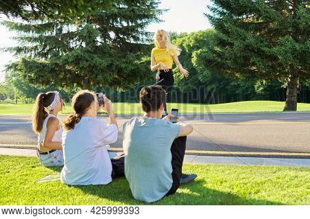 Group Of Hipsters Teenagers Having Fun In Park On Road, Teenage Girl Dancing Street Dance