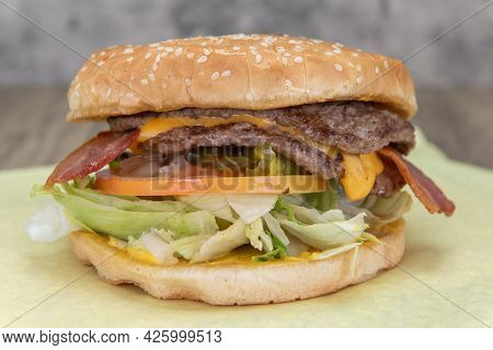 Double Patty Cheeseburger Hamburger Will Fill Any Appetite With Lettuce, Bacon, Tomato, And Sauce Fo