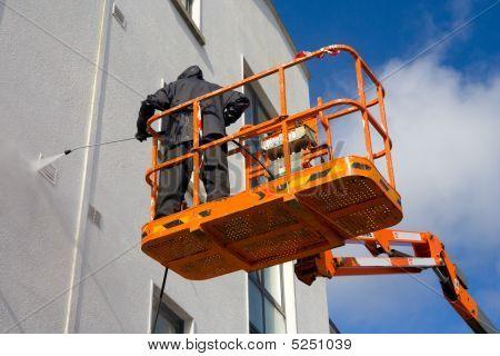 Woker In Platform Washing Building