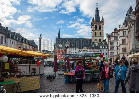 People and stalls at Market square in Trier