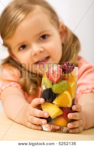 Little Girl Holding A Summer Fruits Salad With Bubbles