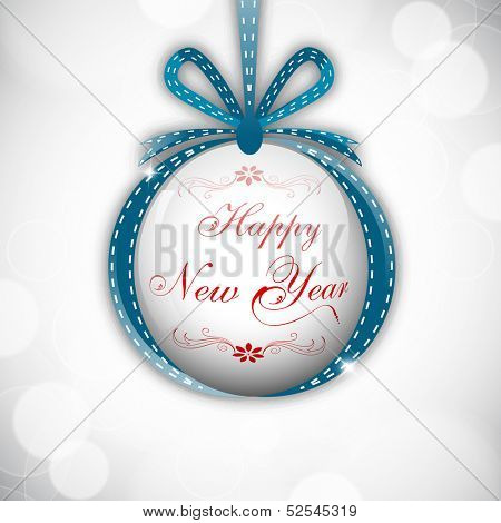 Hanging Xmas ball decorated with ribbon and stylish text on shiny grey background for Happy New Year 2014 and Merry Christmas celebration background.