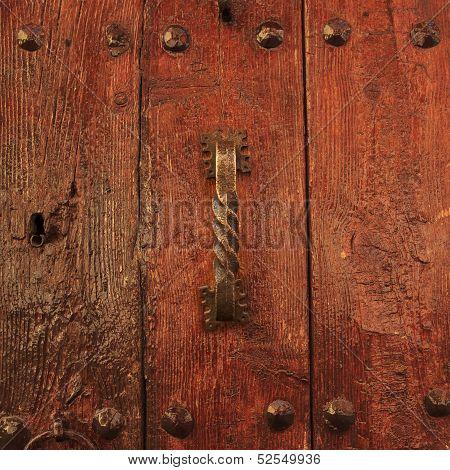 Varnished Wooden Door With Antique Doorhandle