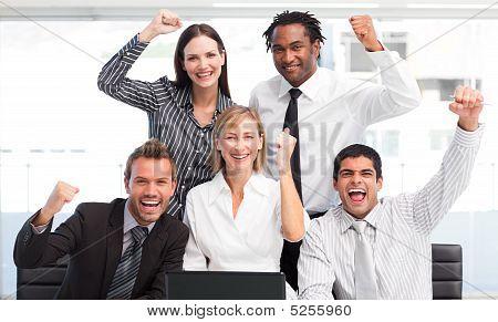 Enthusiastic Business Team Celebrating Success