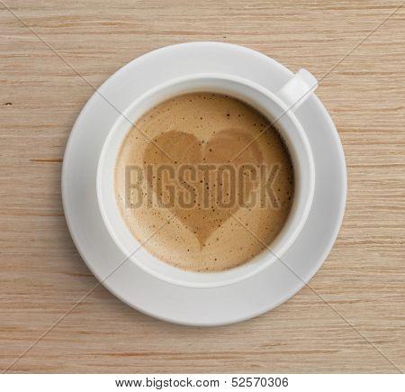 coffee cup with heart shape on foam