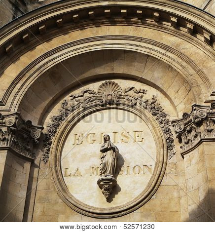 Sculpture at the entrance of Chapel of the Oratory in Avignon, France