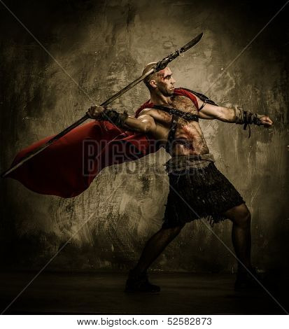 Wounded gladiator in red coat throwing spear poster