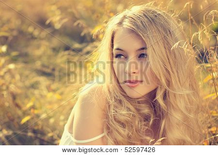 Portrait of Blonde Woman on Nature Background