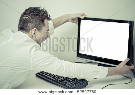 Angry Man Grabbing His Computer With A White Screen