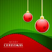 Merry Christmas celebration greeting card with hanging Xmas balls on green and red background.  poster