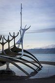Metal sculpture by the sea in Reykjavik Iceland. Solfarid the viking norman boat. poster