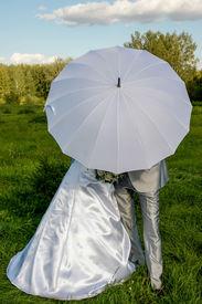 Hidden behind an umbrella
