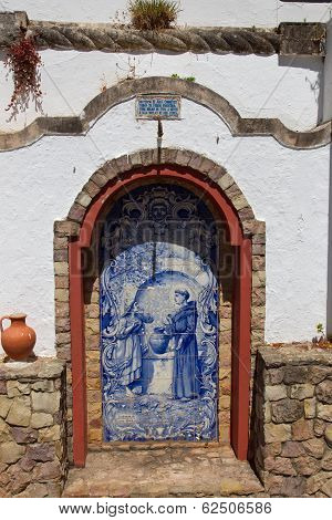 Small altar made of Azulejos in the Alte - famous village in the Algarve Portugal poster