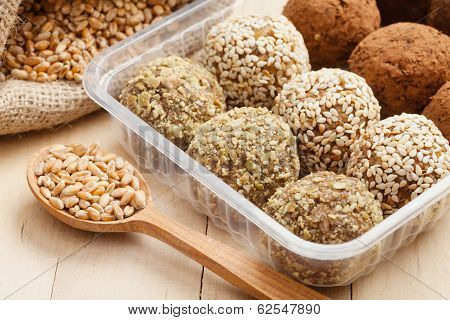 Macrobiotic Healthy Food: Balls From Ground Wheat Sprouts With Sesame, Pumpkin Seeds And Chocolate S