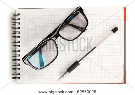 Black men glasses and pen on blocknote