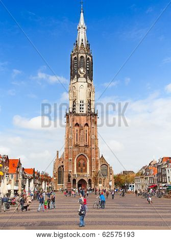 DELFT, NETHERLANDS - MAY 13: People walk near the New Church on May 13, 2013 in Delft. The New Church was completed in 1655 and is used as royal crypt of the House of Orange-Nassau since 1584.