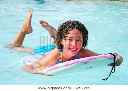 Teen Girl Swimm On Swimming Pool