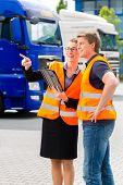 Logistics - proud driver or forwarder and female coworker with tablet computer, in front of trucks and trailers, on a transshipment point, its a good and successful team poster