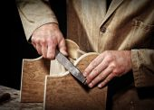 old style craftsman at work fine closeup detail background poster
