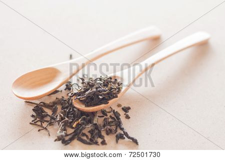 Dry Tea And Wooden Spoons