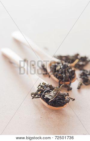 Oolong Tea In Wooden Spoons