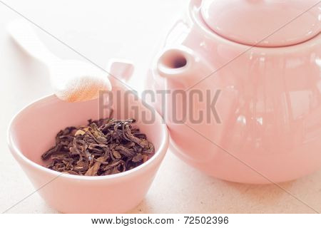 Oolong Tea In Ceramic Cup, Jar And Wooden Spoon