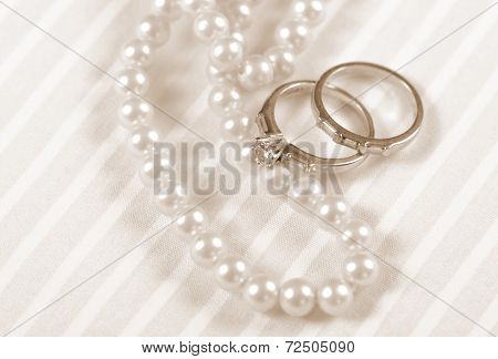 Sepia Vintage Retro Style Wedding And Diamond Engagement Rings With Pearl Necklace Jewelry Closeup M