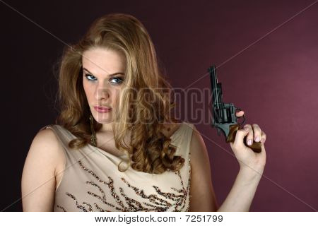 Spy girl with gun pointing up on red background