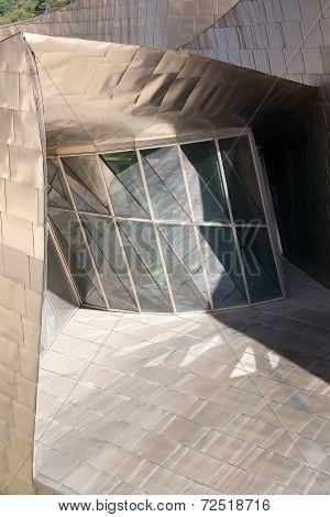 BILBAO, SPAIN - SEPT 3 2014 : A window reflects sunlight from the Guggenheim Museum exterior
