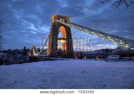 Suspension bridge snow evening
