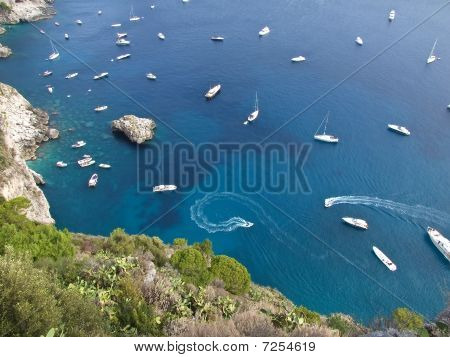 Boats Drifting In A Calm Bay