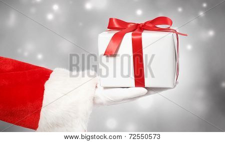 Santa Claus Giving A Christmas Gift