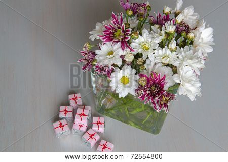 Vase With Flowers And Candy