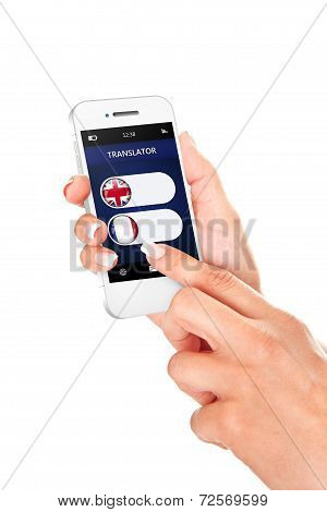 Hands Holding Mobile Phone With Language Translator Application Over White