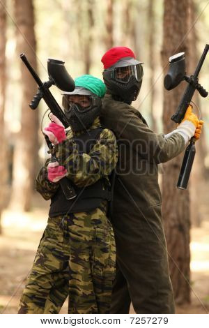 Two Young People Playing Paintball