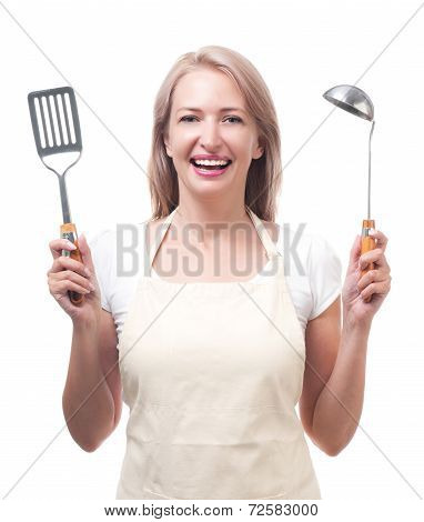 Beautiful housewife with ladle and spatula. Isolated on white background