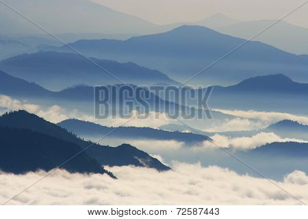 Blue and foggy mountains