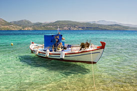 Moored Fishing Boat In The Clear Sea Water