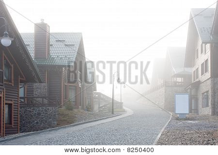Chalets In Fog