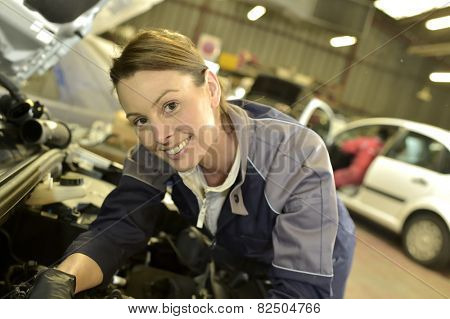 Technician woman working in auto repair workshop poster