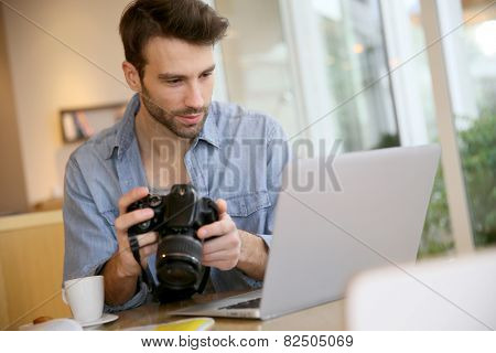 Student in photography working with laptop