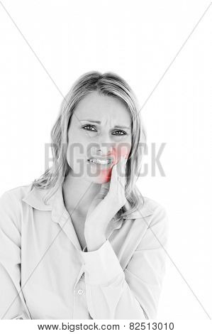 Dejected businesswoman with toothache against white background