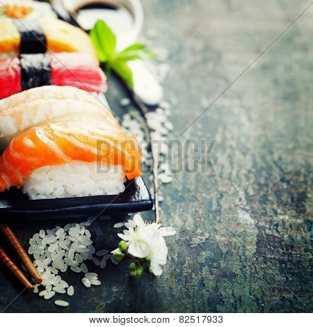 sushi with chopsticks on old  wooden background