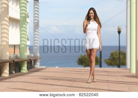 Sexy Woman Walking And Texting On The Smart Phone